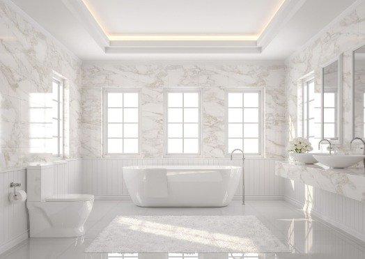 tiling in a white and bright bathroom at Mackay Tilers